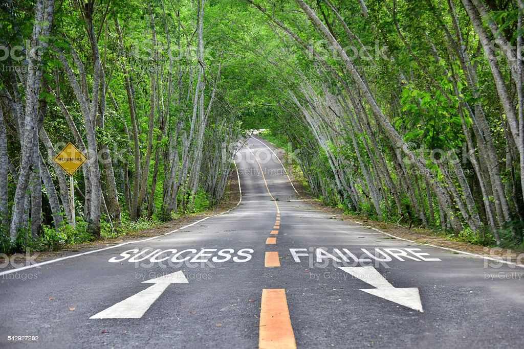 Words of success and failure on road surface stock photo
