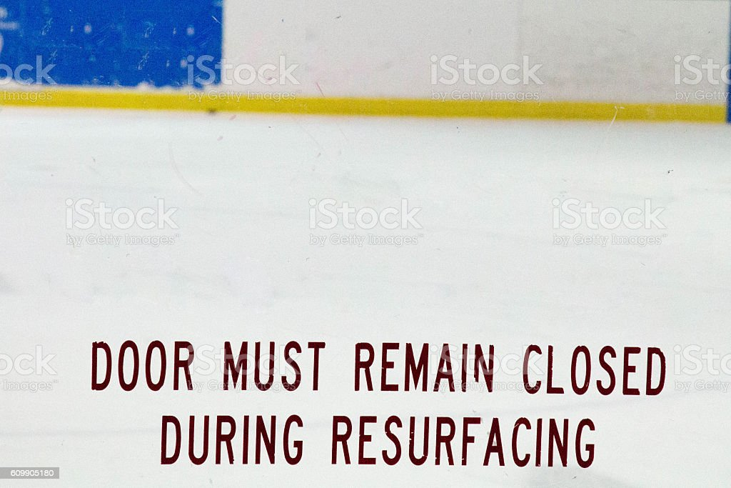 Words on Plexiglass at a ice rink stock photo