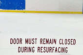 Words on Plexiglass at a ice rink