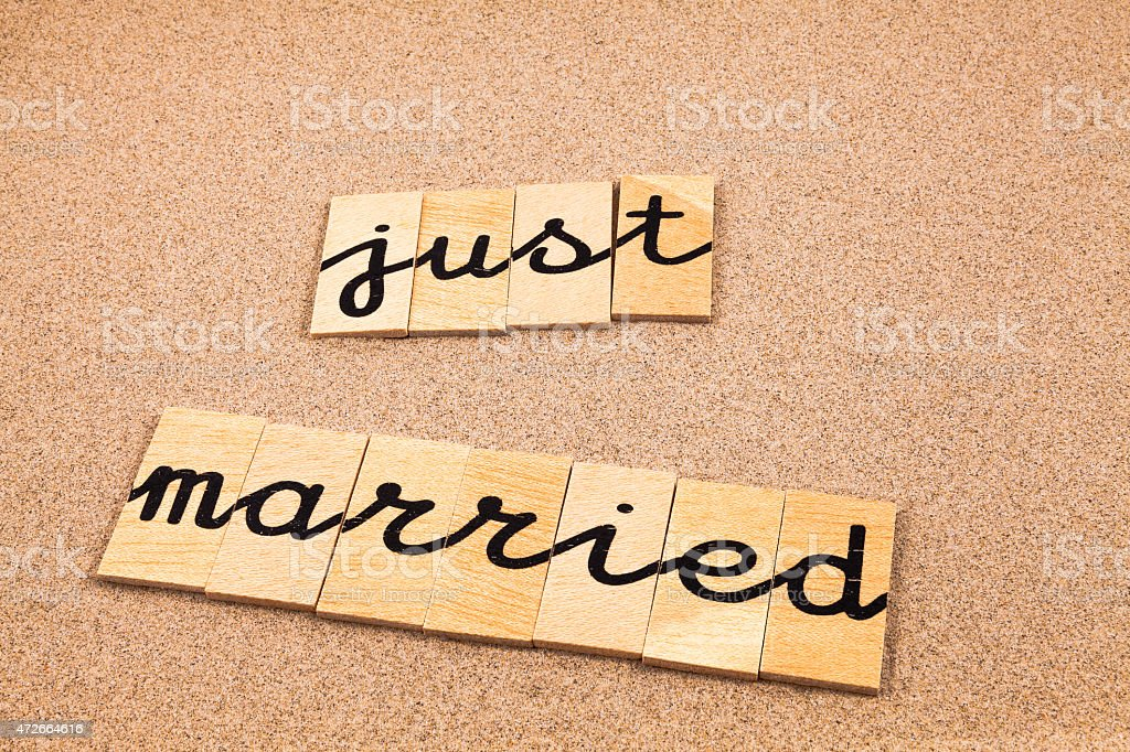 Words on sand just married stock photo