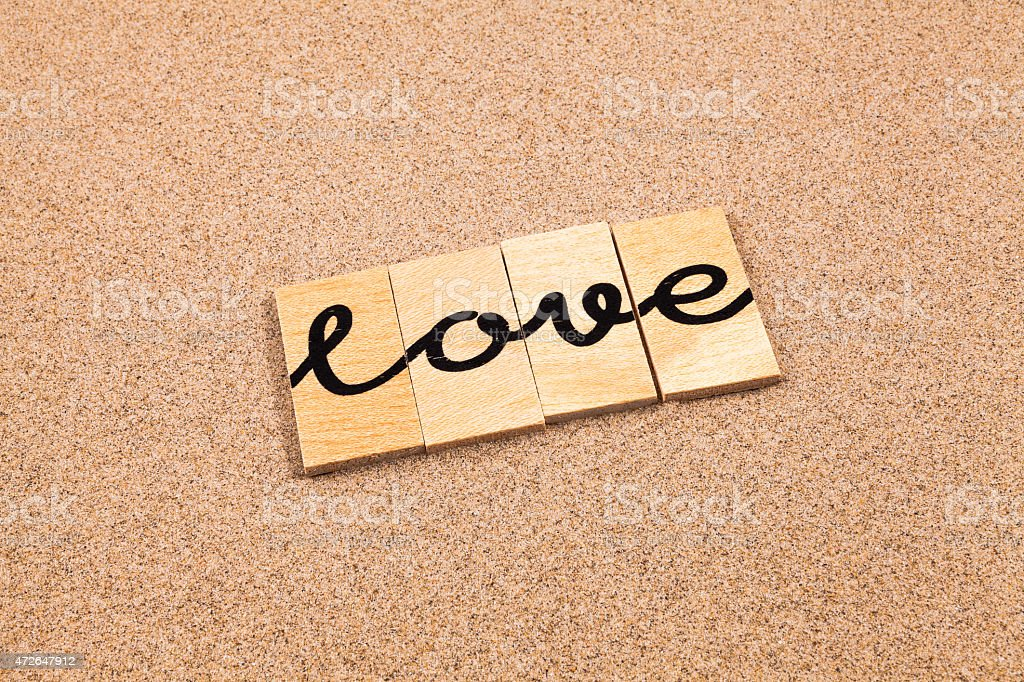 Words on sand love stock photo