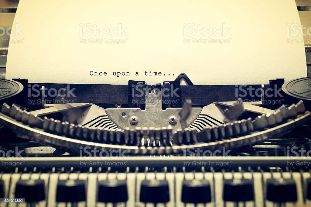 Words 'Once upon a Time' written with old typewriter stock photo