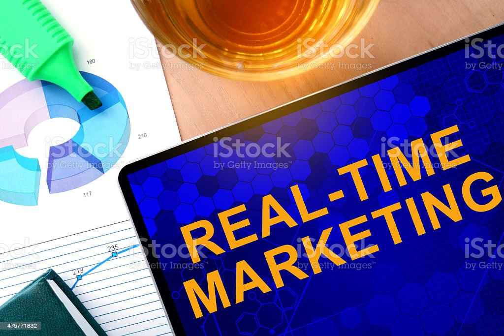Words Real-Time Marketing on the tablet and charts. stock photo