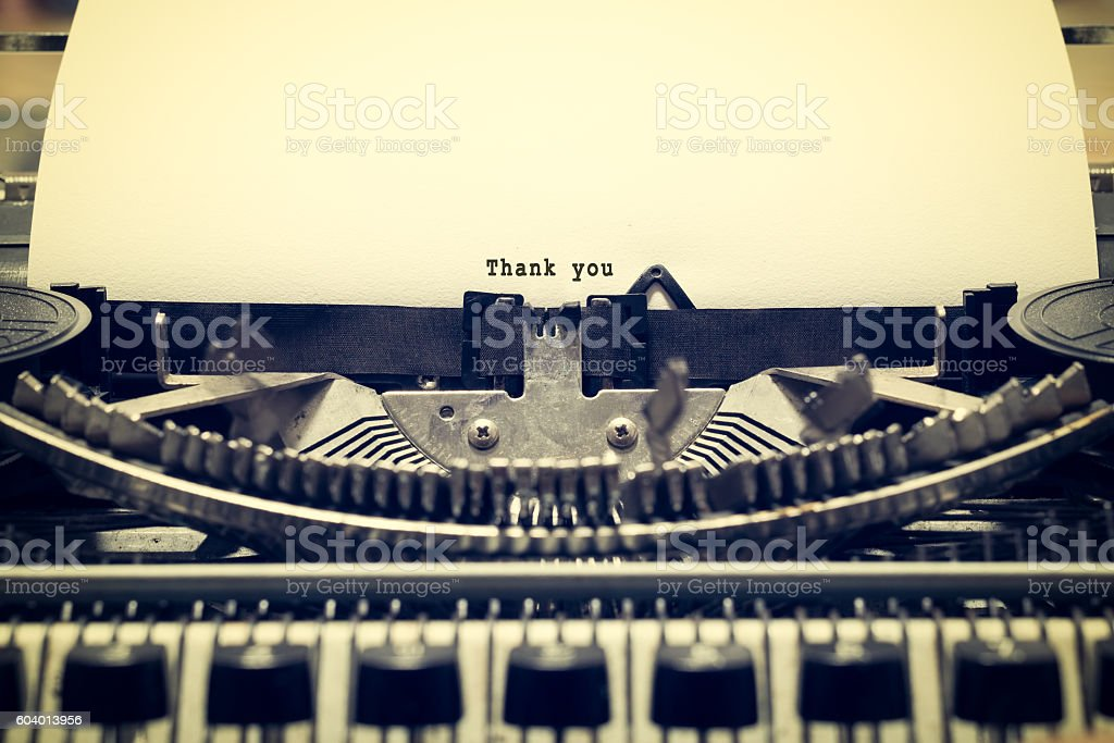 Words 'Thank you' written with old typewriter stock photo