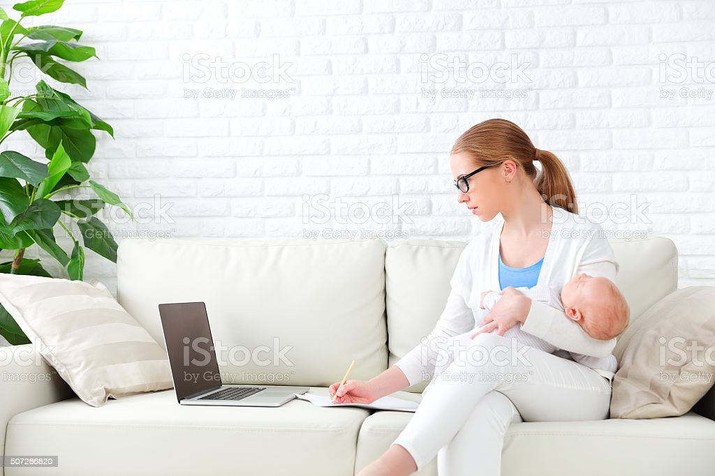 work and business through Internet at home for mothers stock photo