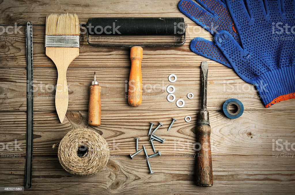 work and painting tools on the wooden background top view stock photo