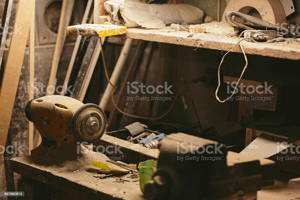 work bench with an electric emery night stock photo