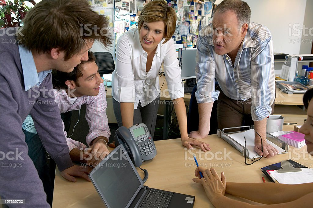 Work Colleagues discussing a project royalty-free stock photo