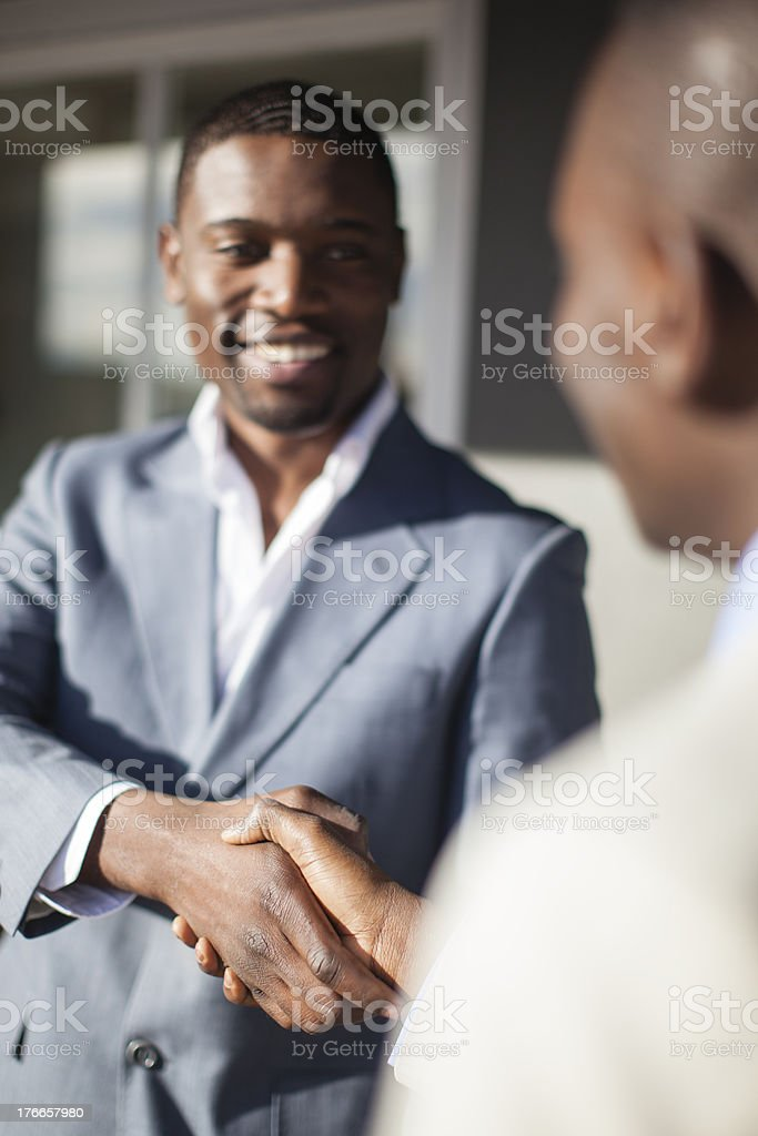 Work colleagues shaking hands, Cape Town, South Africa royalty-free stock photo
