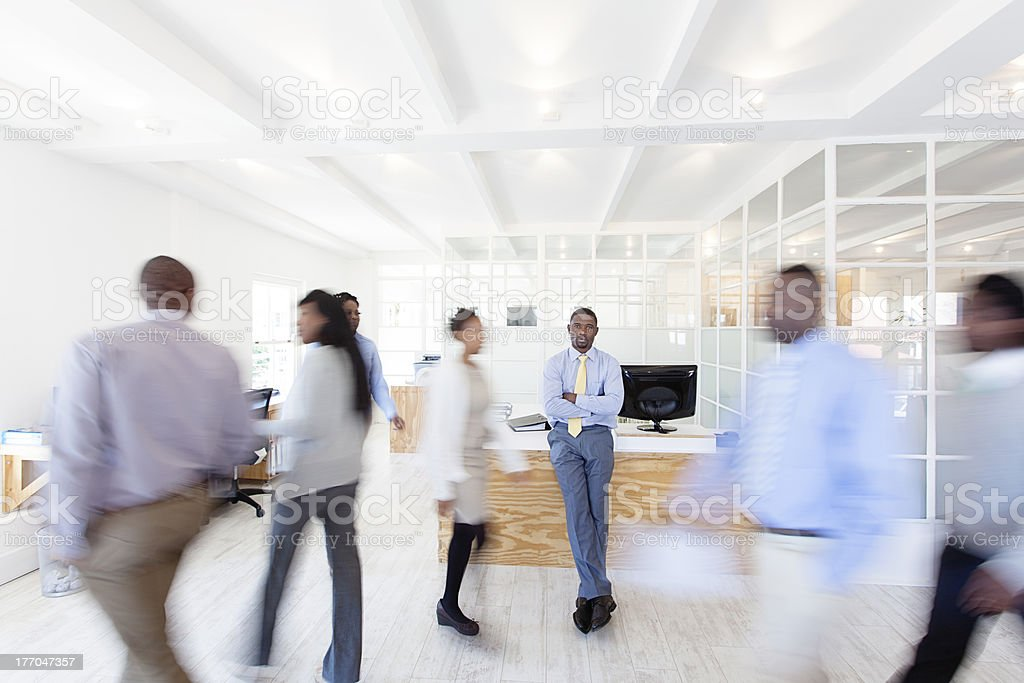 Work Colleagues walking around their office, Africa stock photo