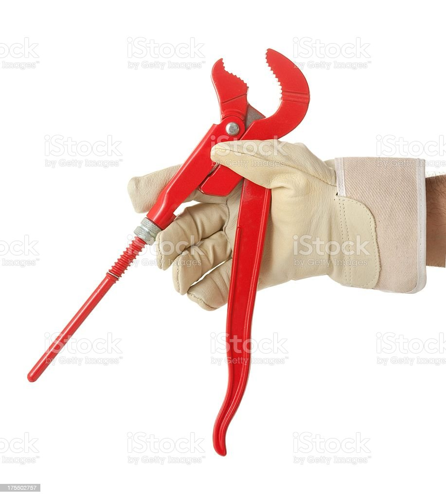 Work glove holding red pliers stock photo