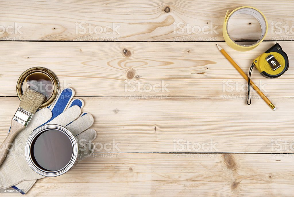 Work gloves, brush, can of paint stock photo