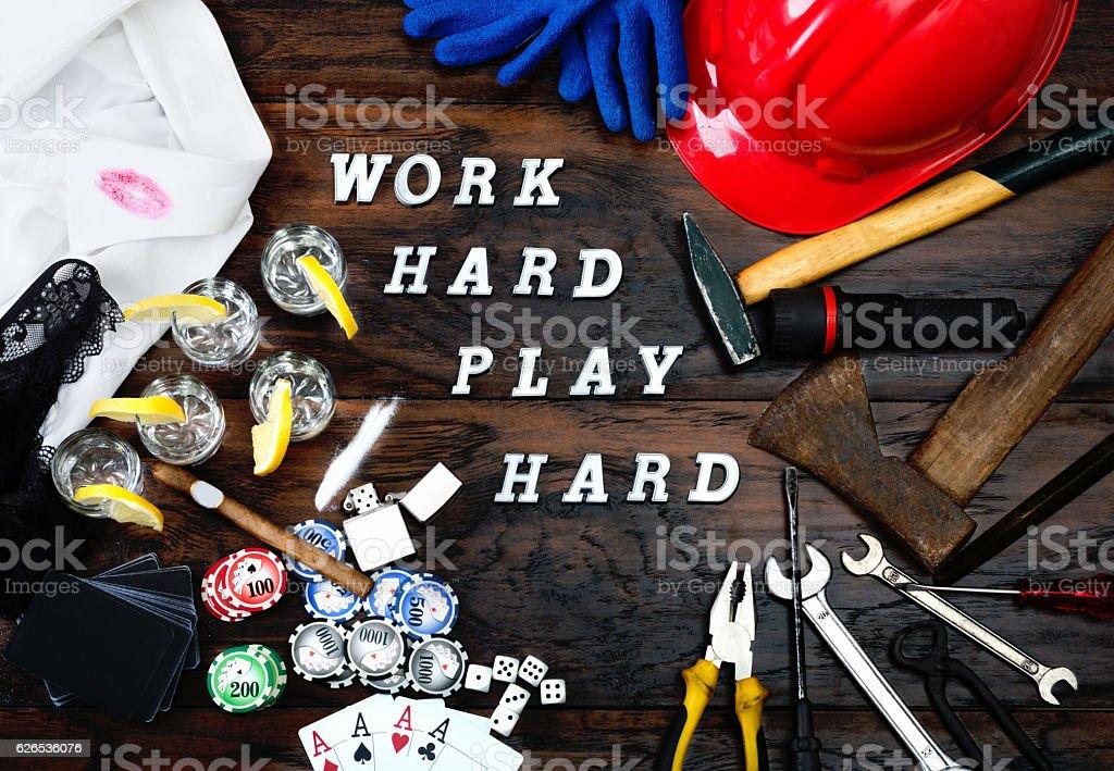 Work hard play hard written on the wooden table. stock photo