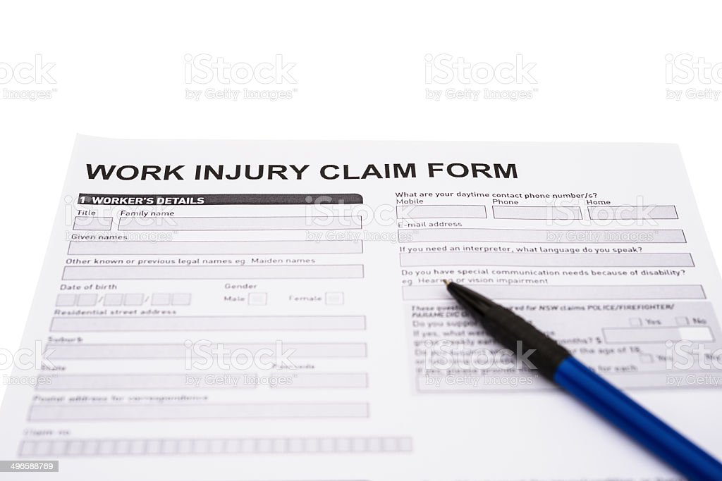 work injury claim form on white with clipping path stock photo