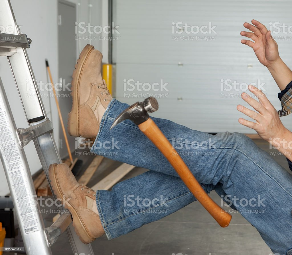 Work injury falling off a ladder stock photo
