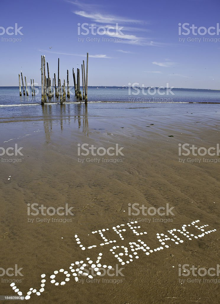 Work life balance packed with sea shells royalty-free stock photo