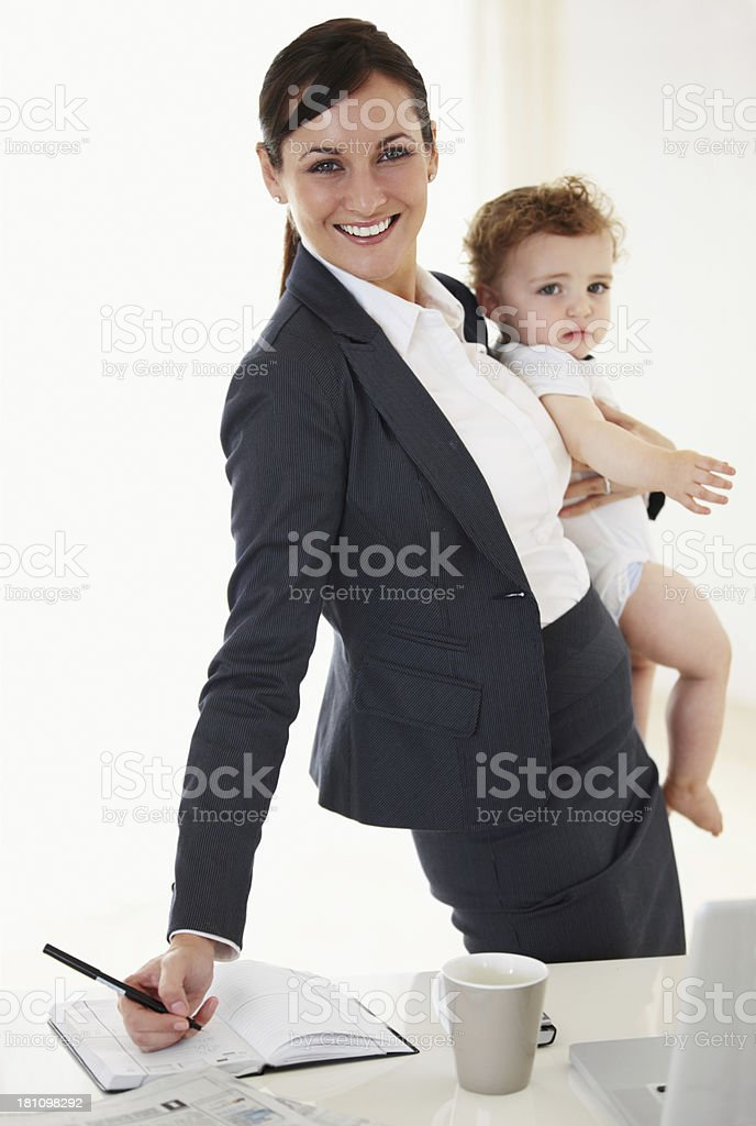 Work meets motherhood..and she's got it covered! royalty-free stock photo