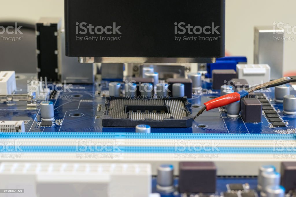 Work on the soldering station to replace the cpu socket stock photo