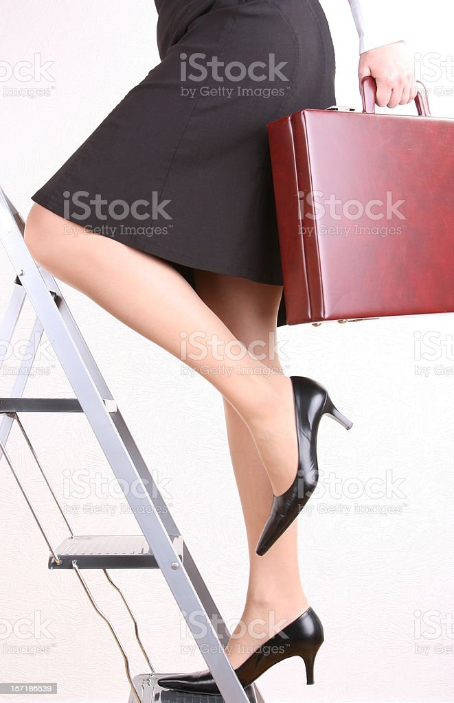 Work one's way up fast Woman stock photo