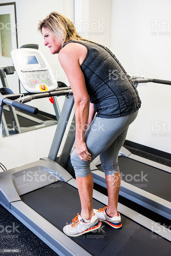 Work out injury in the gym stock photo