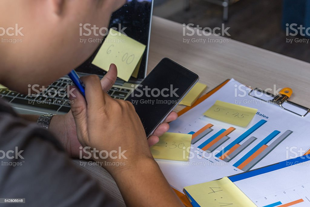 Work overtime at home to finish report before deadline stock photo