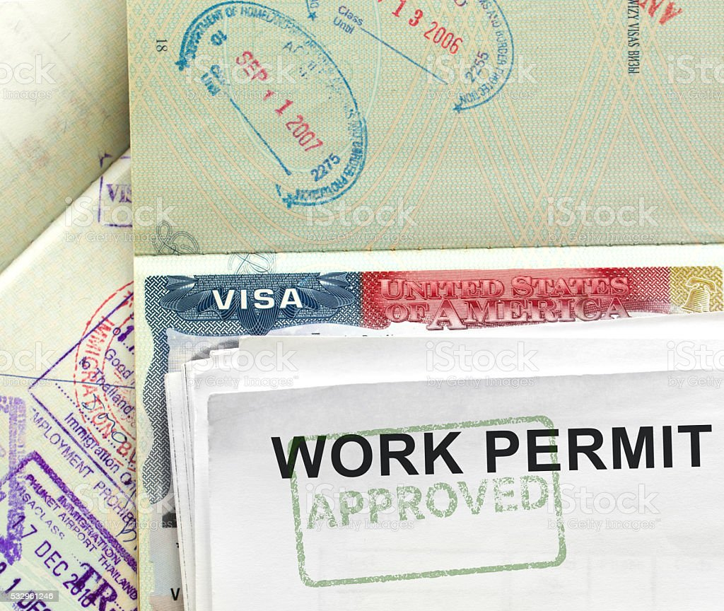 Work permit approval with Us visa and passport stock photo