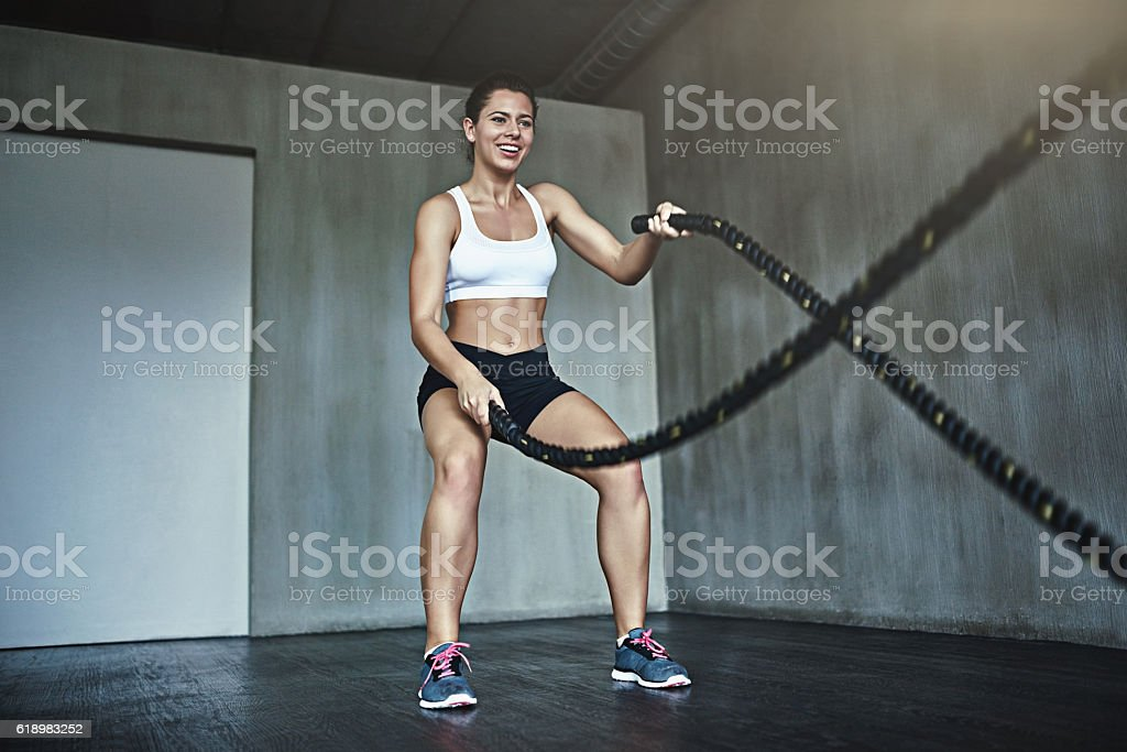 Work that waistline with a battle rope workout stock photo