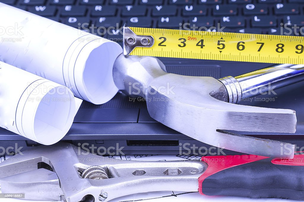 work tool and blueprint with laptop royalty-free stock photo