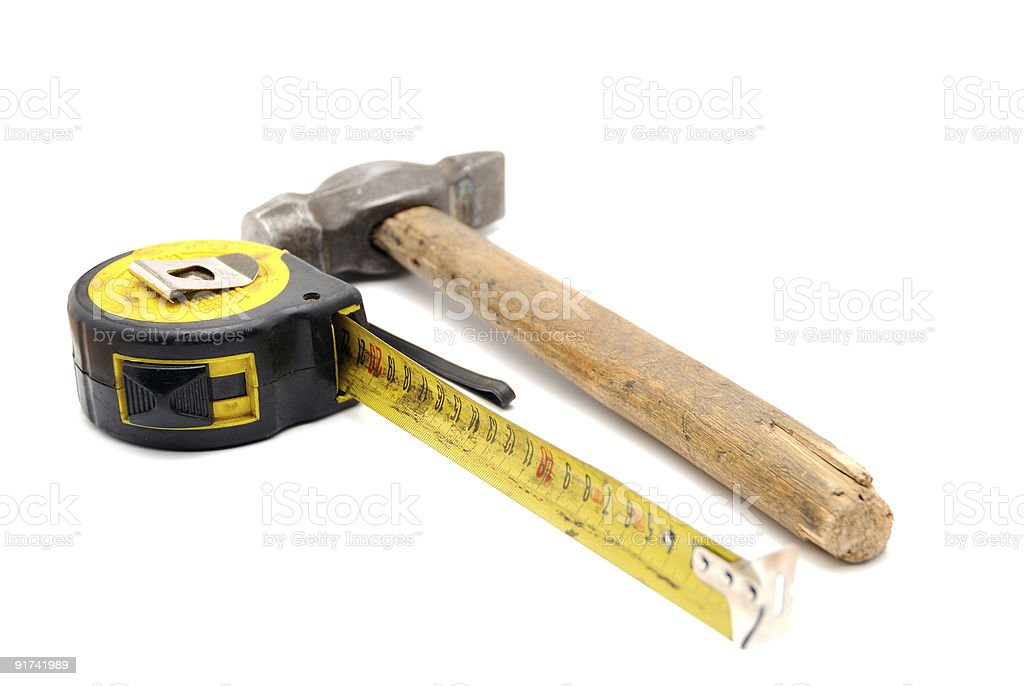 Work tool series: Old tape measure and hammer stock photo