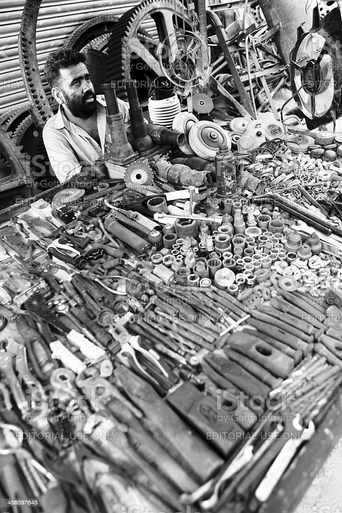 Work Tools and Big Industrial Cogwheel at Karachi Scrap Market royalty-free stock photo