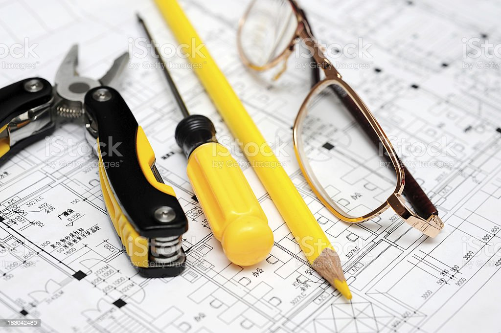 Work Tools and Eyeglasses on Blueprint royalty-free stock photo
