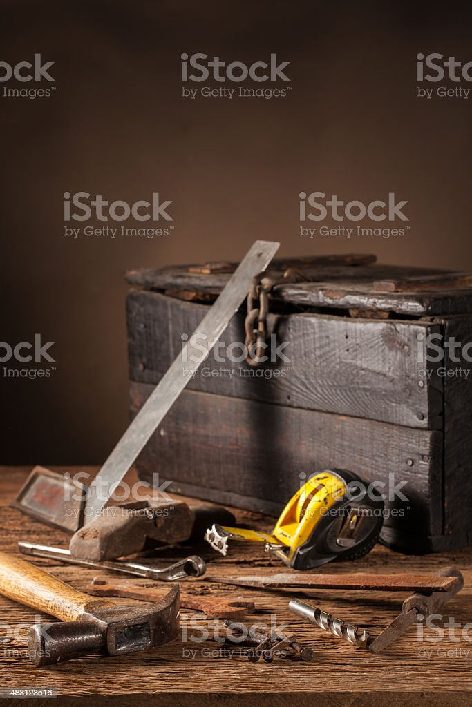 Work tools chest on a wooden table stock photo