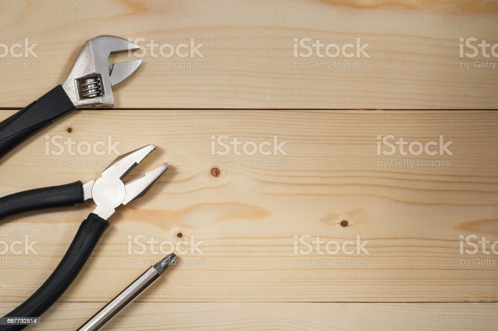 Work tools on a wooden table. Flat lay. Copy space. Color toning. stock photo