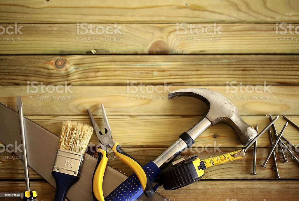 Work tools on wooden background stock photo
