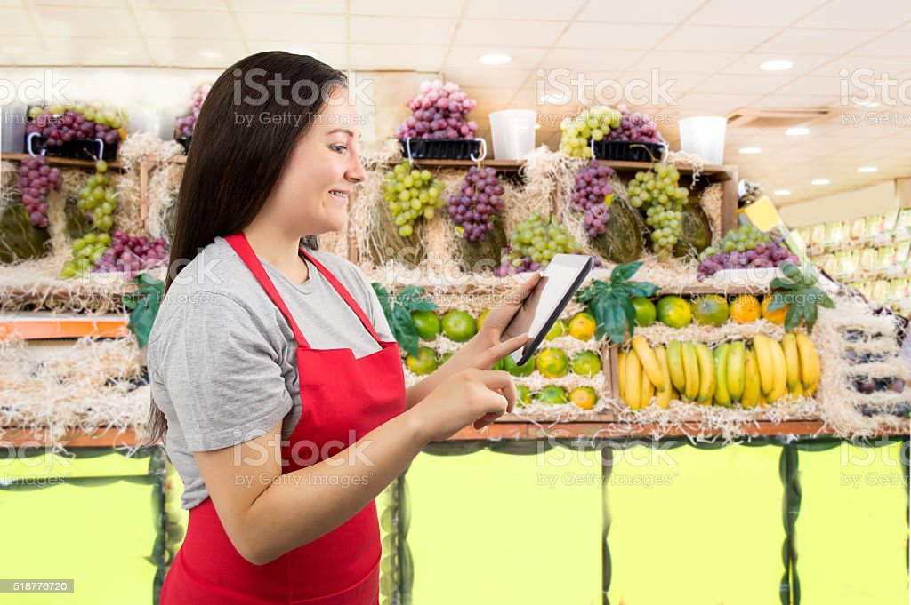 work with tablet at the greengrocery stock photo