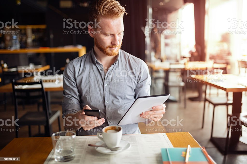 Workaholic businessman on break stock photo