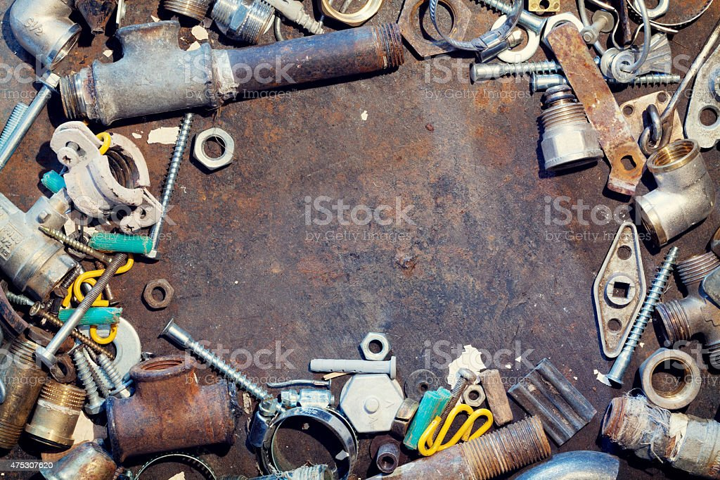 Workbench metal table with old water supply parts stock photo