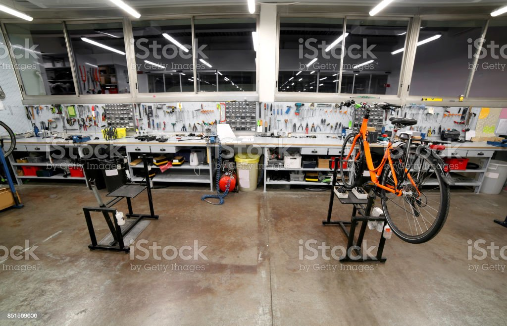Workbench with many tools inside a mechanic workshop specialized stock photo