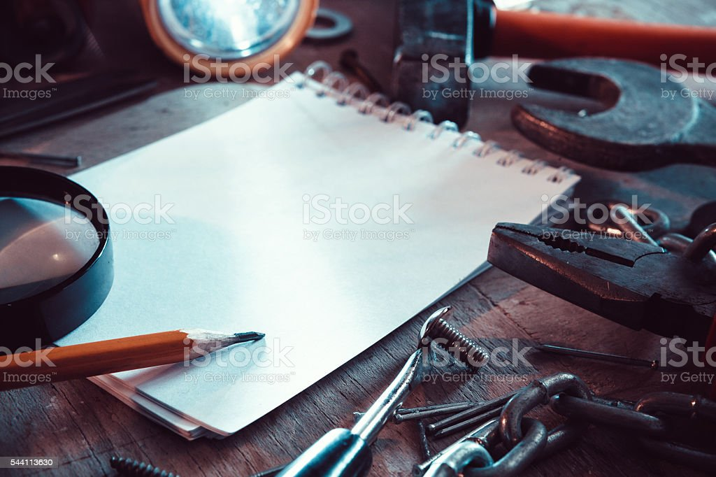 Workbench with notebook and pencil stock photo