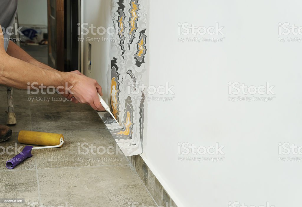 Worker adhesive wallpapers. stock photo