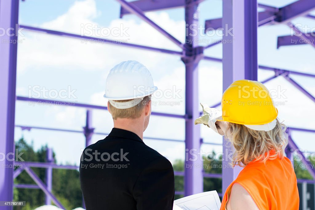 Worker  and architect at construction site royalty-free stock photo