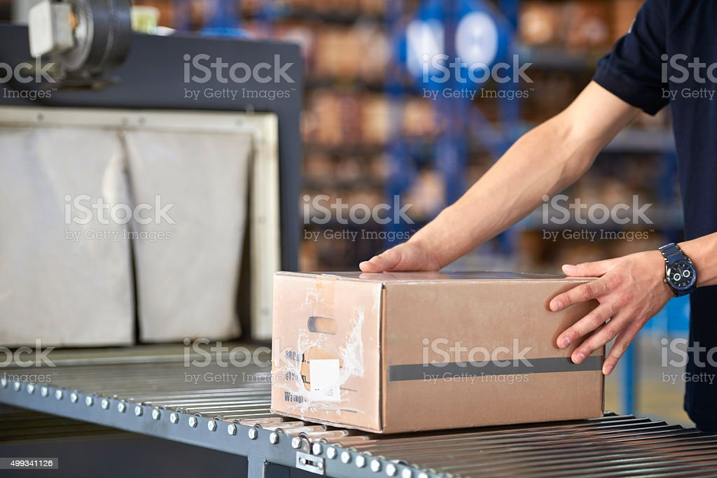 Worker and box in warehouse stock photo