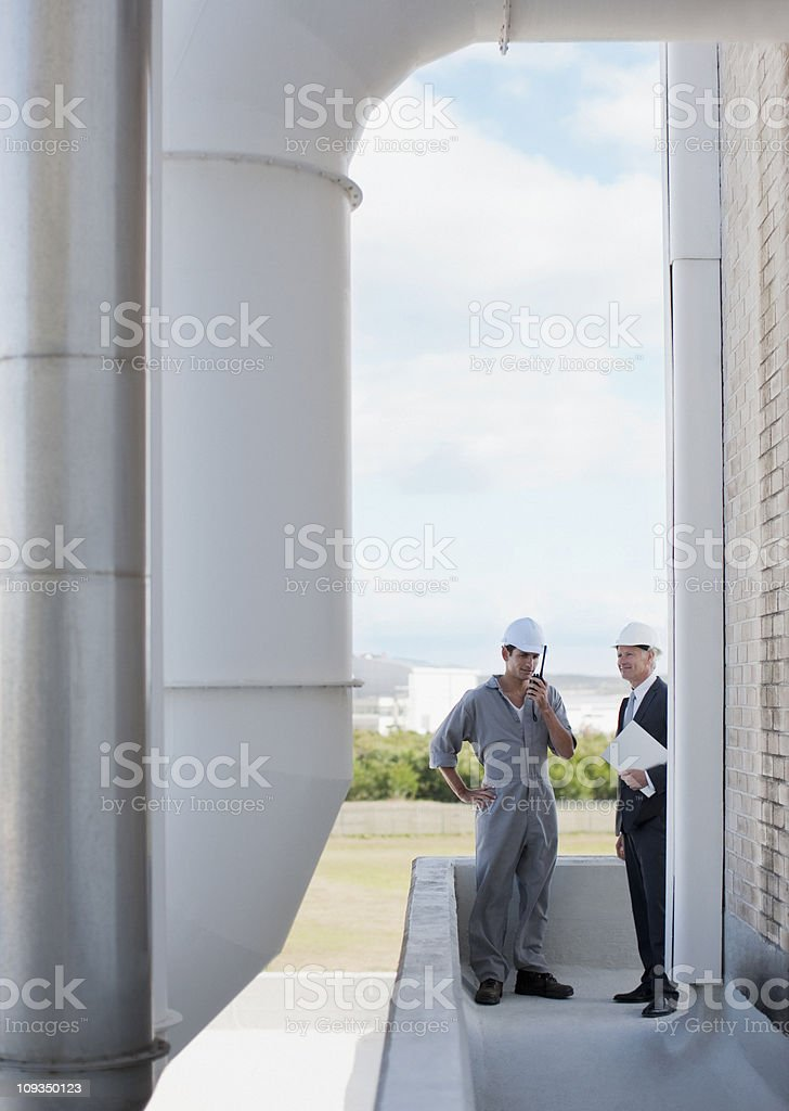 Worker and business people standing together outdoors stock photo