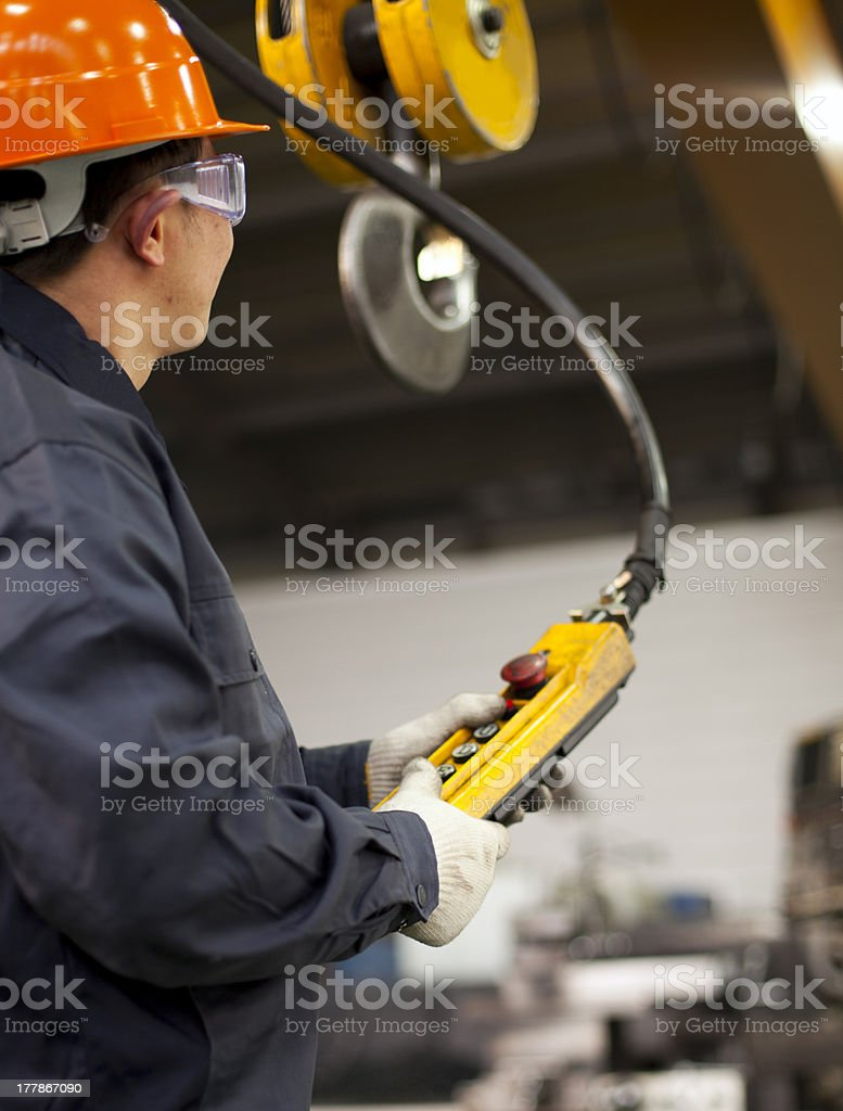 Worker and crane hook stock photo