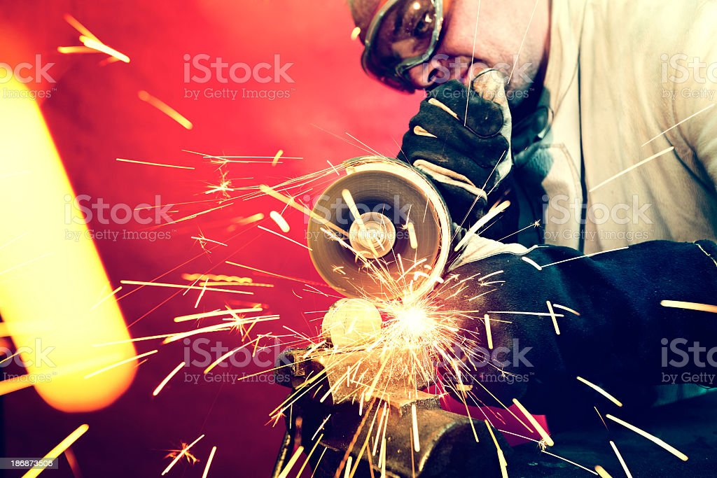 Worker and grinder royalty-free stock photo
