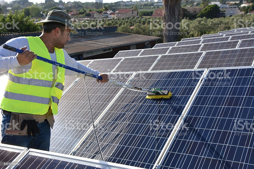 worker and solar panels stock photo