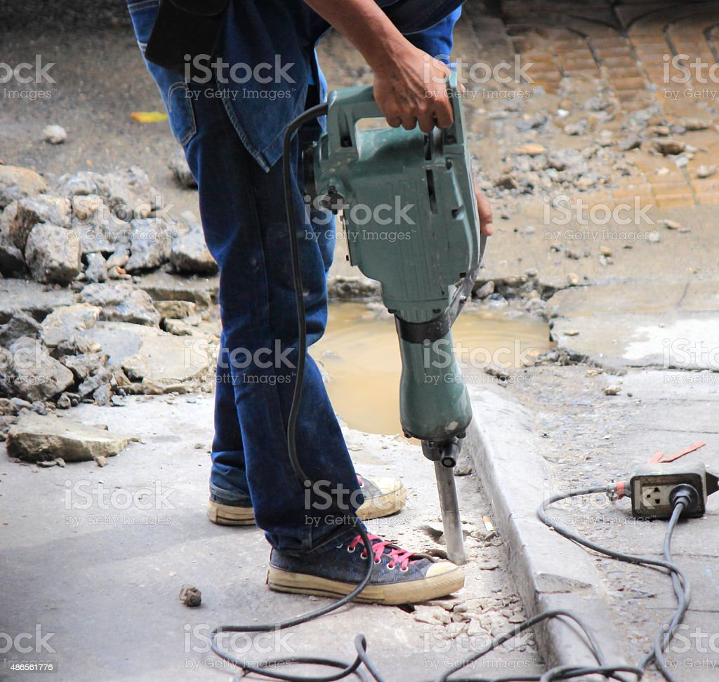 Worker are drilling concrete floor. stock photo