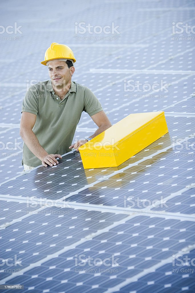 Worker at a photovoltaic farm stock photo