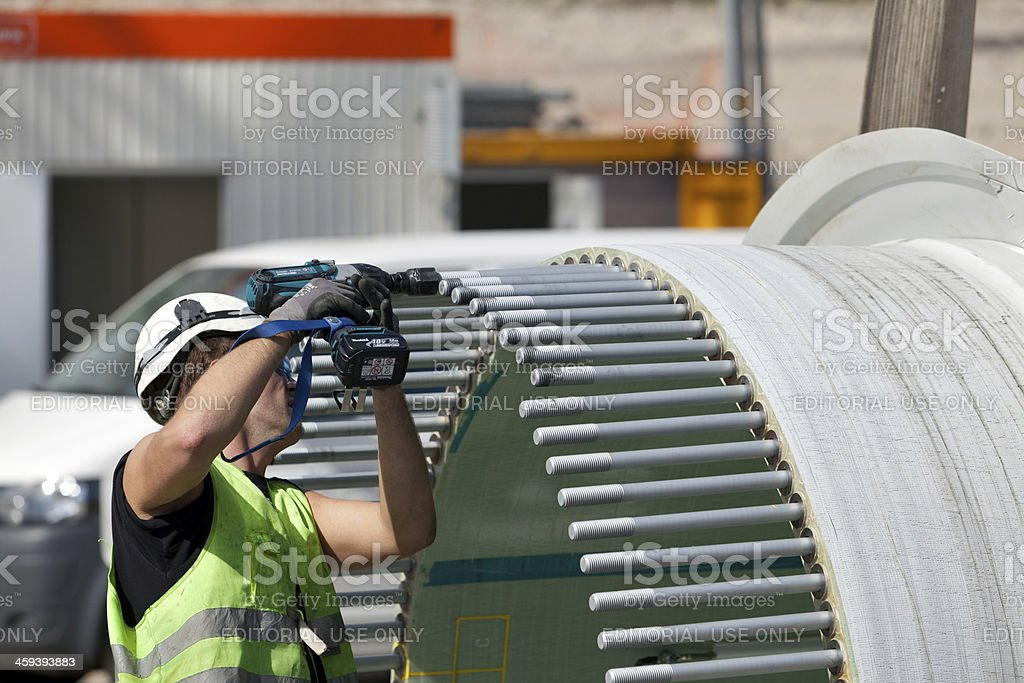 Worker at a wind turbine construction site stock photo