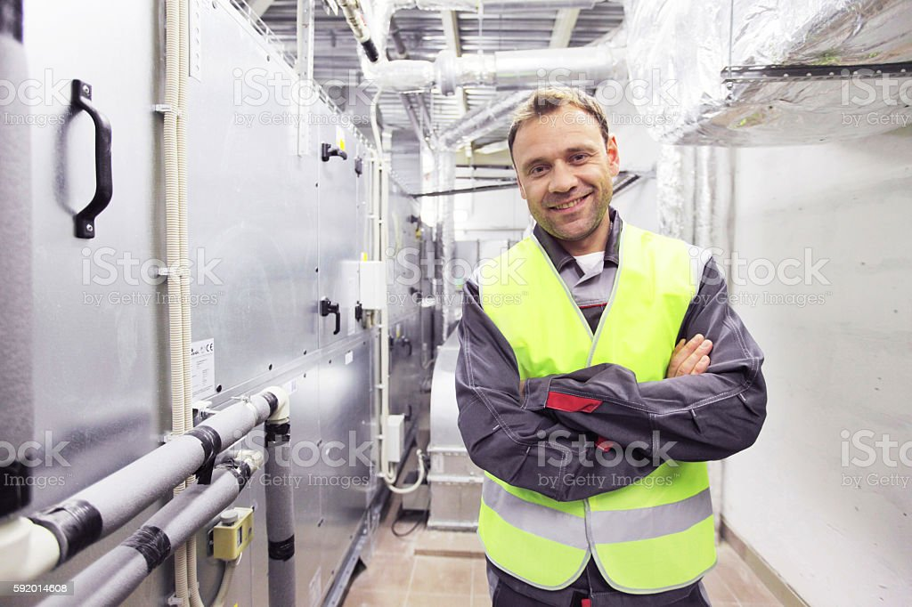 Worker at CNC plant stock photo